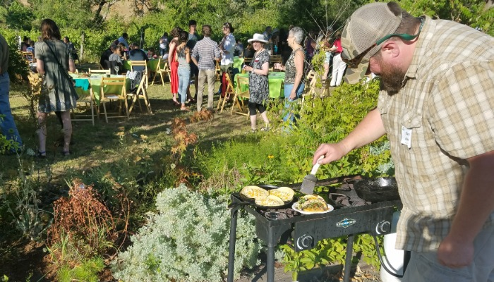 Randy Bonner cooking walleye tacos on site at the 2018 Invasive Species Cook-Off at Harris Bridge Vineyards, near Corvallis, Oregon.