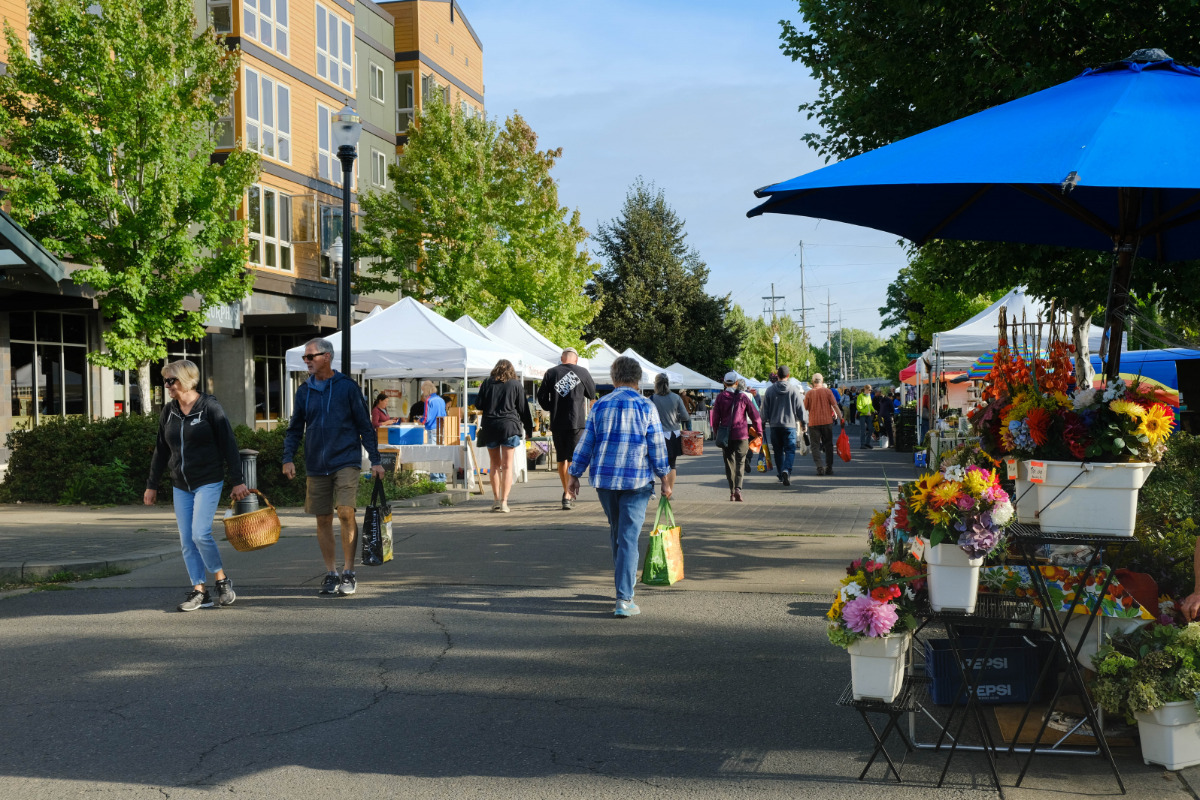 Corvallis Farmers Market, Corvallis, Oregon - Tents and booths along First Street in Corvallis, Oregon, making up a busy farmers market.