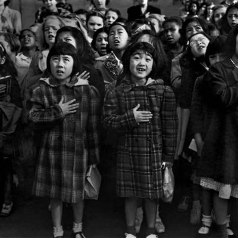 Pledging allegiance to the flag at Raphael Weill Public School in San Francisco, 1942. Dorothea Lange, Courtesy of National Archives.