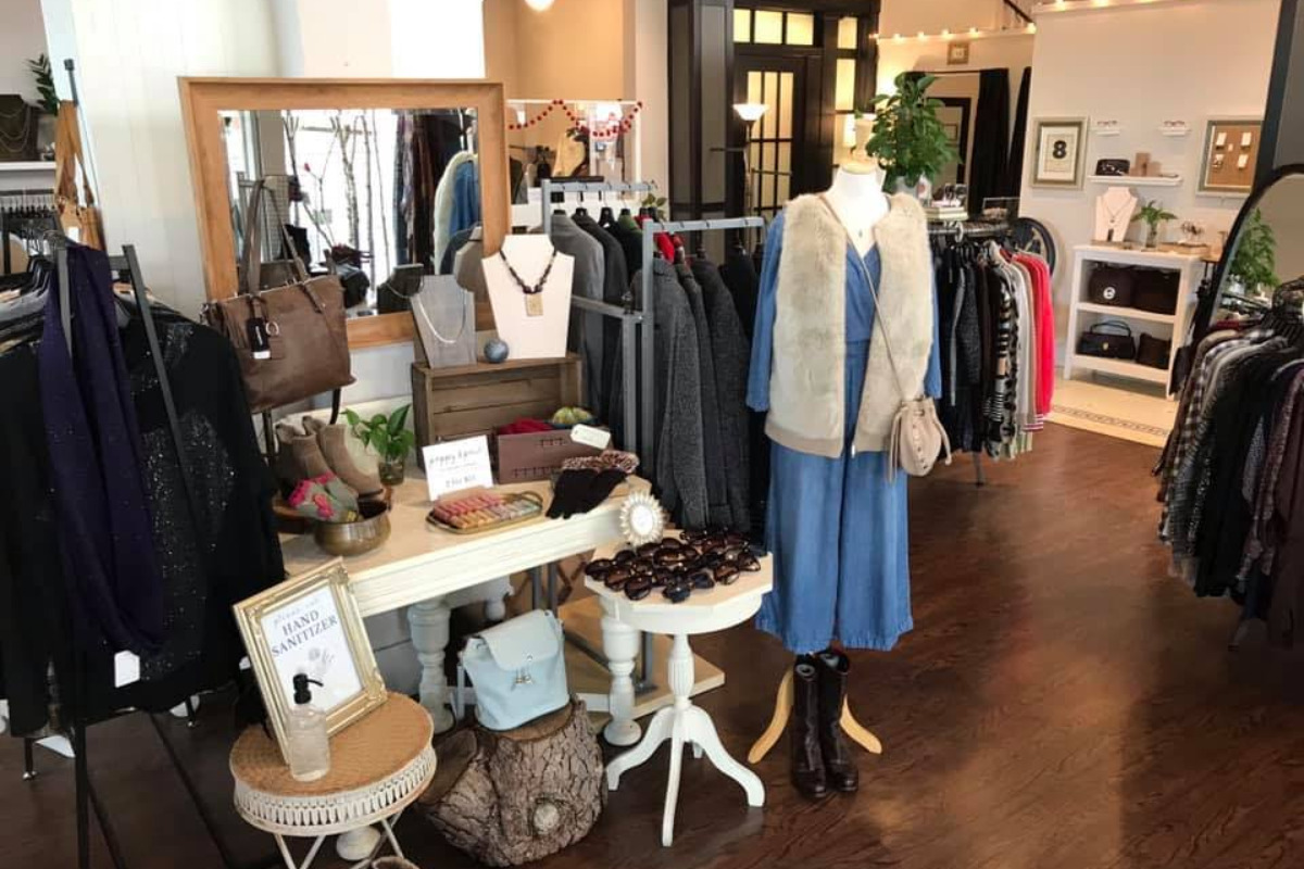 Revolve, Corvallis, Oregon - The inside of a resale boutique showing men's and women's clothes and accessories - via Facebook
