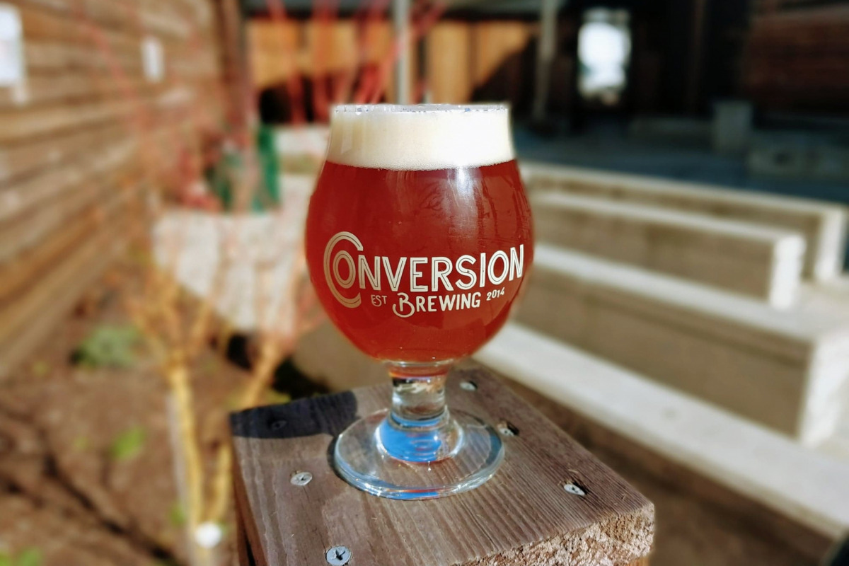 Conversion Brewing, Lebanon, Oregon, Closeup on logo glass full of craft beer, image via Facebook