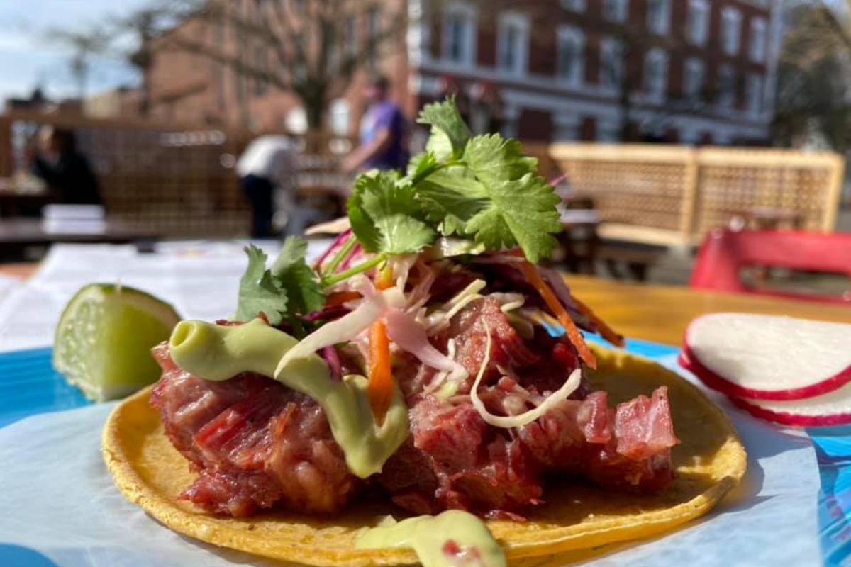 TacoVino, Corvallis, Oregon - A TacoVino taco sits on an outdoor table - Image via Facebook