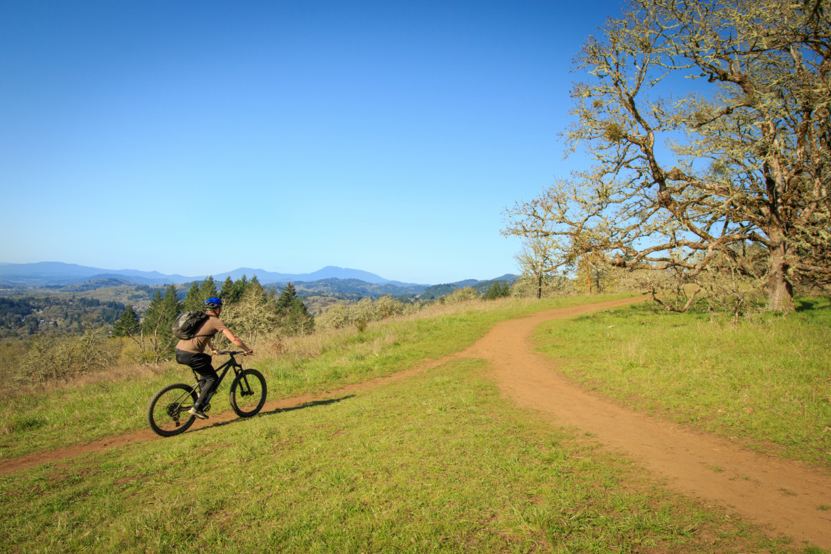 Chip Ross Park and Natural Area, Corvallis, Oregon - A cyclist bikes the trails at Chip Ross Park, enjoying gorgeous views of Marys Peak
