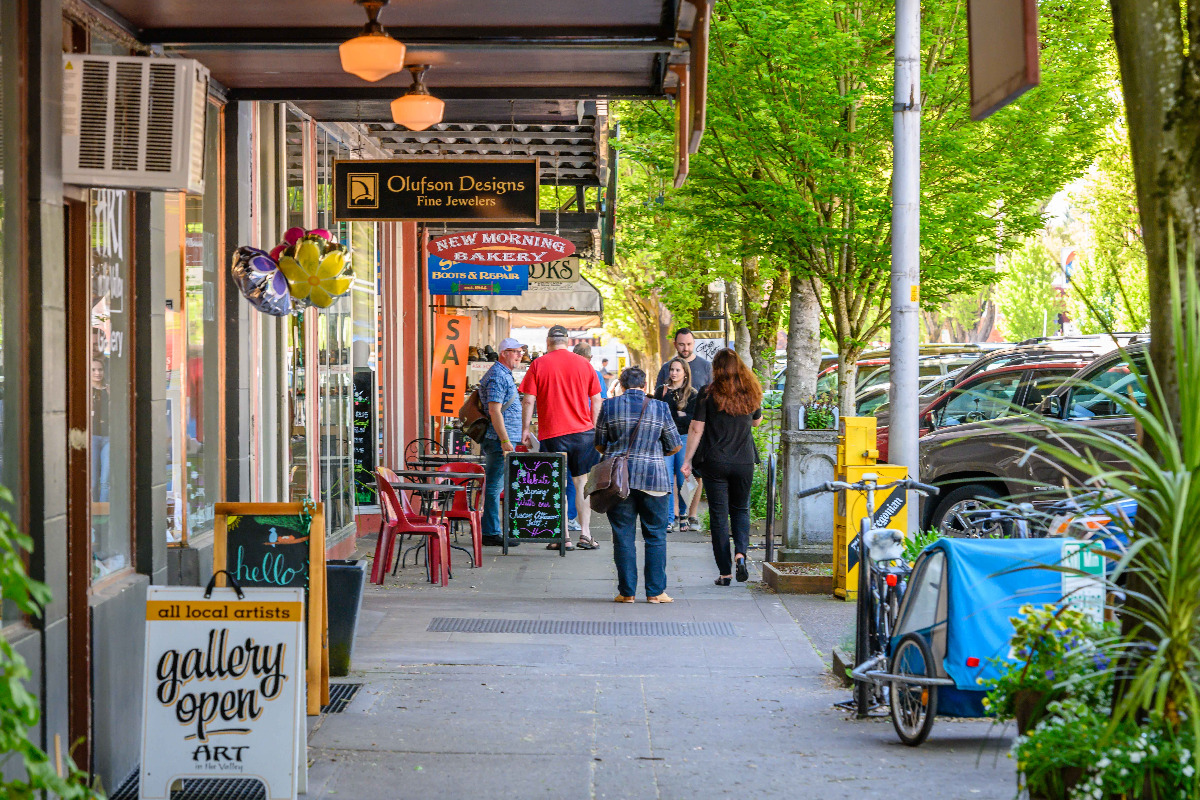 Downtown Corvallis, Oregon - Shoppers browse the storefronts along 2nd Street in downtown Corvallis - By Reed Lane Photography