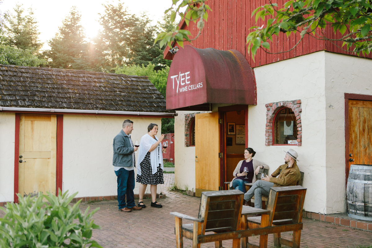 Tyee Wine Cellars, Corvallis, Oregon - Two couples, physically distanced, drink wine outside Tyee's tasting room, which is a converted creamery.