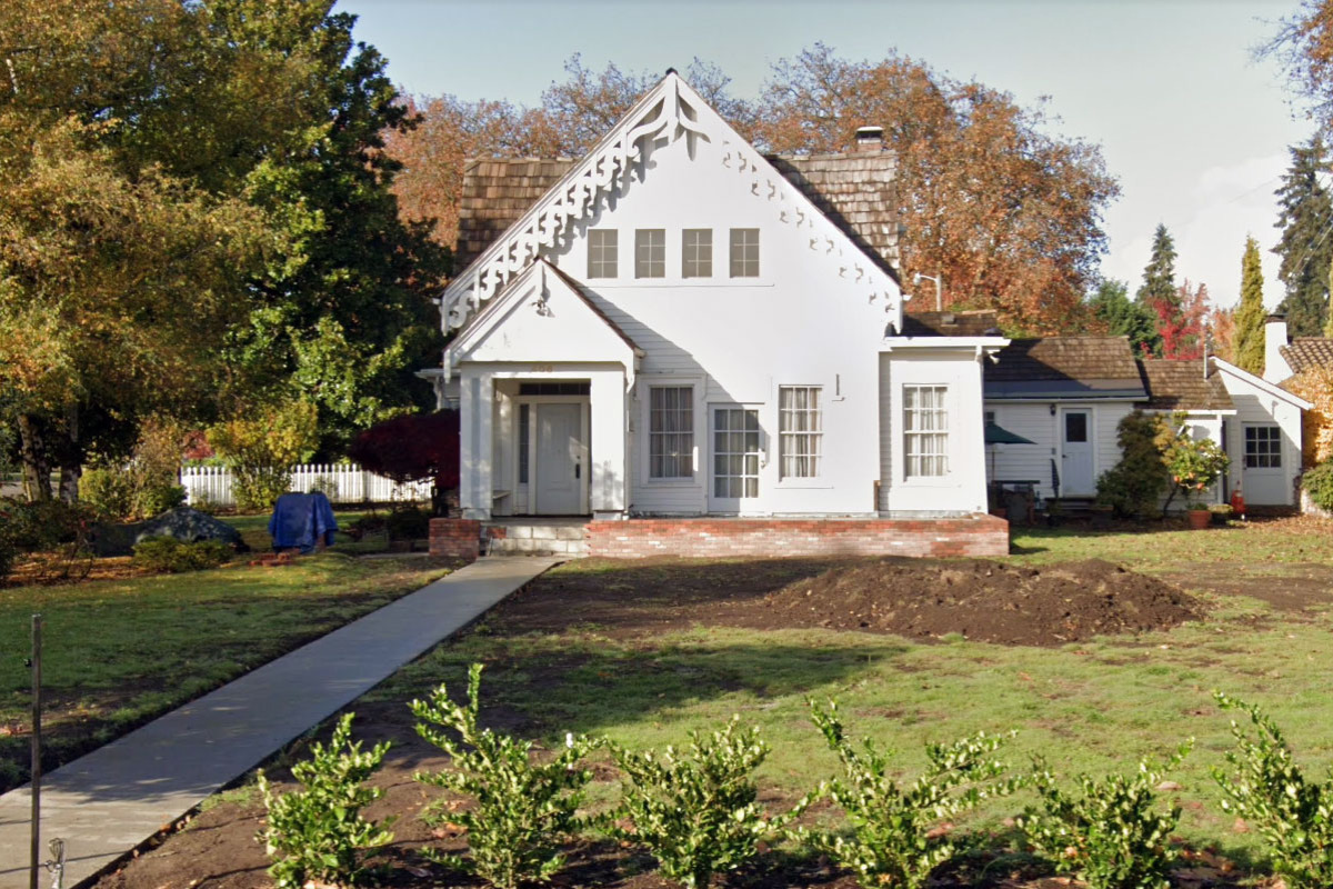 The Biddle-Porter House in Corvallis, Oregon is a white gothic revival-style home built around 1856 that features beautifully scalloped eaves