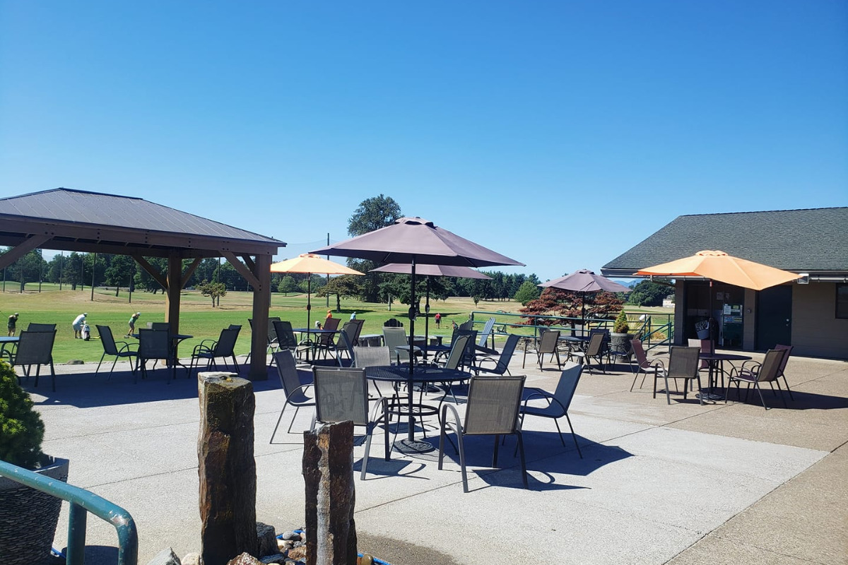 Trysting Tree Golf Club, Corvallis, Oregon, Back patio with tables, chairs, sun shades