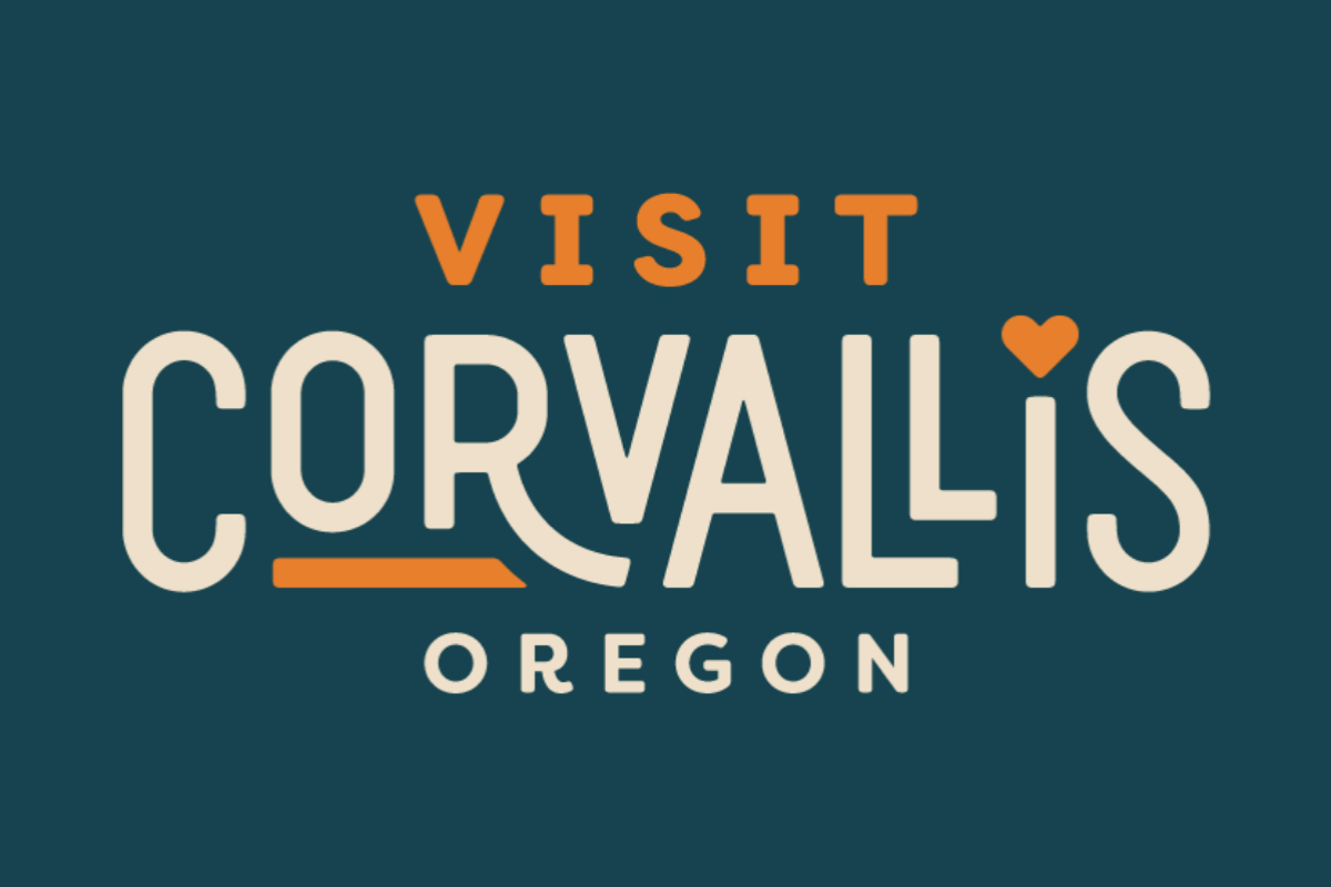 Logo for Visit Corvallis, featuring orange- and sand-colored text on a navy blue background