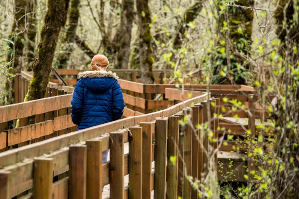 A girl walks along the Muddy Creek Boardwalk in the William L. Finley National Wildlife Refuge.